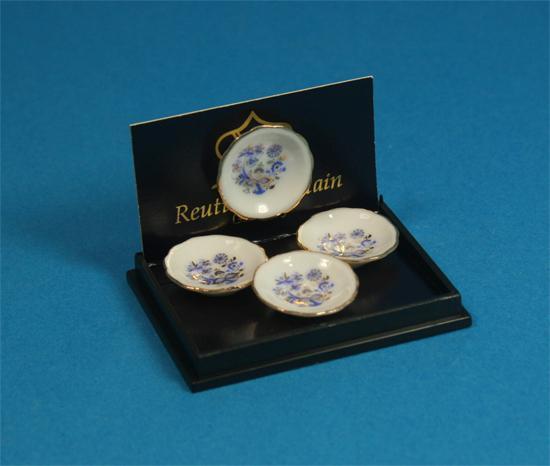 Re13888 - Cuatro platos decoración azul