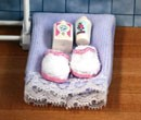 Tc1541 - Asciugamano e pantofole